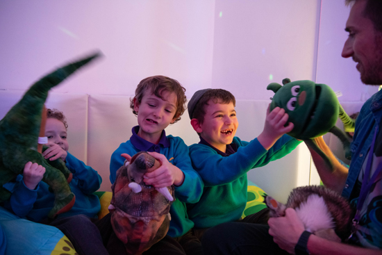 Dramatherapy session with Mr Chris Dramatherapist in the sensory room using puppets as a tool to explore social and emotional understanding